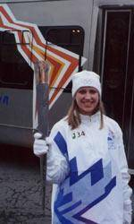Lady Tiger Strength Coach Carries Olympic Torch