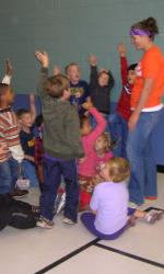 Solid Orange Squad Visits Sara Collins Elementary School