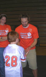 Solid Orange Squad Members Help Out at Tiger Cub Club Birthday Party
