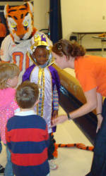 Solid Orange Squad Members Visit Marshall Elementary School